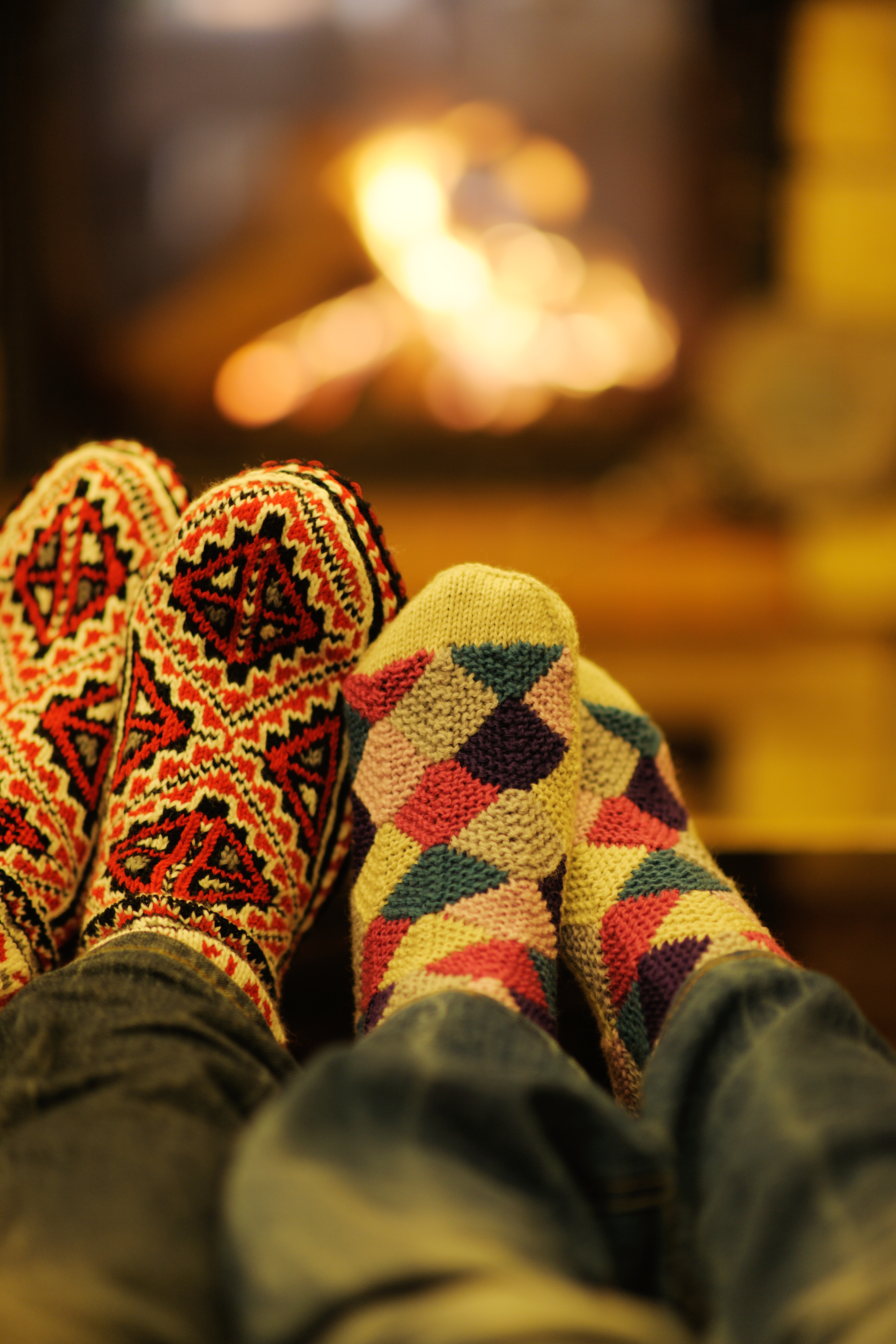 happy Young romantic couple and relaxing sofa in front of fireplace at